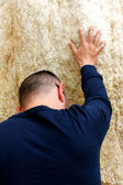 Unidentified man praying at the Wailing wall (Western wall) — Stock Photo