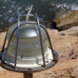 Stock Photo: New lantern on walking dam walls off marinfrom sea