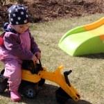 Beautiful little girl playing in the yard — Stock Photo #24785381
