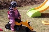 Beautiful little girl playing in the yard — Stock Photo