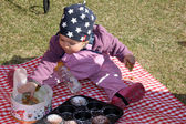 First picnic on the grass near house — Stockfoto