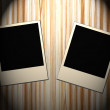 Blank old picture frames  on wooden background — Stock Photo