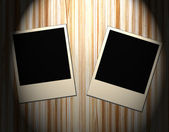 Blank old picture frames on wooden background — Zdjęcie stockowe