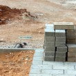 Sidewalk construction and stack of concrete blocks — Stock Photo