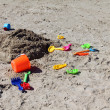 Children's toys on the beach sand — Stock Photo