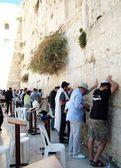 JERUSALEM, ISRAEL - DECEMBER 10: Jewish worshipers pray at the Wailing Wall an important jewish religious site on December 10, 2013 in Jerusalem, Israel — Stock Photo