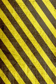 Yellow and black grunge warning sign — Foto Stock