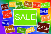 Multi colored Sale signs background — Stockfoto
