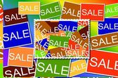Multi colored Sale signs  background — Stock Photo