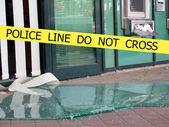 Police line do not cross sign tape on damaged by explosion building background — Zdjęcie stockowe