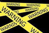 Warning  tapes on black background — Stock Photo