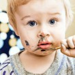 Royalty-Free Stock Photo: A cute little baby she paints