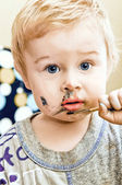 A cute little baby she paints — Stock Photo