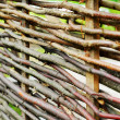 Wattle fence of wooden rods — Stock Photo