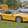 Yellow Pontiac Fiero side view - Stock Photo