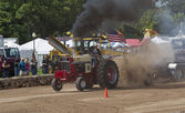 International Tractor pulling smoke everywhere — Stock Photo