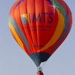 Orange IMTS Balloon in sky - Stock Photo