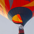 Orange IMTS Balloon in sky close up - Stock Photo