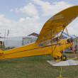 Yellow Piper Cub Plane ready for Alaska - Stock Photo