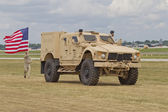 Soldier, Flag and Humvee at EAA — Stock Photo