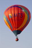 Orange IMTS Balloon in sky — Stock Photo