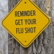 Royalty-Free Stock Photo: Reminder Get Your Flu Shot Sign