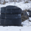 Stock Photo: Stack of Discarded Tires in snow
