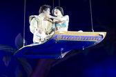 Aladdin and Jasmine on the Magic Carpet Embrace — Stock Photo