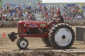 The Little Bomb Red Tractor — Stock Photo