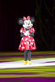 Minnie Dressed Up in Red Dress on Skates — Stock Photo