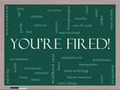 You're Fired Word Cloud Concept on a Blackboard — Stock Photo