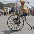 Man Riding High Wheel Bicycle Side View — Stock Photo