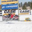 Stock Photo: Polaris Red Snowmobile Soaring on Jump