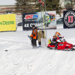 Stock Photo: Tiny Polaris Red Snowmobile Starting to Race