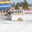 Stock Photo: Polaris Red & Black Snowmobile Soaring on Jump