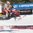 Stock Photo: Polaris Red & Black Snowmobile in Air