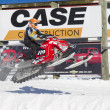 Stock Photo: Polaris Red & Black Snowmobile Getting some Air