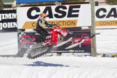 Polaris Red & Black Snowmobile Getting some Air — Stock Photo