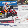 Stock Photo: Red and Black Polaris Snowmobile Racing in Air