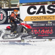 Stock Photo: Red and Black Polaris VForce Snowmobile Racing in Air