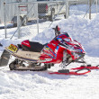 Stock Photo: Red and Black Polaris Snowmobile After Race