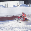 Stock Photo: Red and Black Polaris Snowmobile Racing over jump