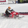 Stock Photo: Red and Black Polaris Snowmobile during race