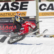 Stock Photo: Red and Black Polaris Snowmobile crashing down