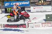 Red and Black Polaris Snowmobile Racing in Air — Stock Photo
