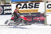 Red and Black Polaris VForce Snowmobile Racing — Stock Photo