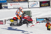 Red and Black Polaris Snowmobile Racing High in Air — Stock Photo