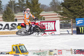 Red and Black Polaris Snowmobile Racer Pointing to crowd — Stock Photo