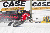 Red and Black Polaris Snowmobile crashing down — Stock Photo