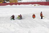 Two snowmobiles making a turn — Foto Stock
